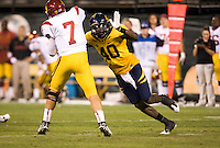 October 13th, 2011:  Chris McCain of California pressured Matt Barkley of USC during a game at AT&T Park in San Francisco, Ca  -  USC defeated California 30 - 9
