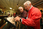 EUREKA, SD - OCTOBER 10, 2007: Edmund Opp, left, and Al Neuharth, founder of USA Today and the Freedom Forum, look at an old photo at the Eureka Pioneer Museum in Eureka, SD. (Photo by Dave Eggen/Inertia/Freedom Forum)