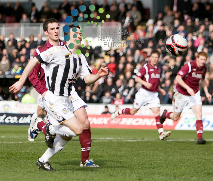 Steven Thomson gets past hearts Lee Wallace during The Clydesdale Bank Premier League match between St Mirren and Hearts at St Mirren park Paisley 03/04/10..Picture by Ricky Rae/universal News & Sport (Scotland).