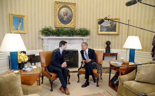 United States President Barack Obama, right, and Prime Minister Justin Trudeau, left, hold a bilateral meeting in the Oval Office of the White House March 10, 2016 following an Official Arrival Ceremony in Washington,D.C.<br /> Credit: Olivier Douliery / Pool via CNP/MediaPunch