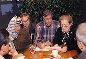 United States Secretary of State Madeleine Albright examines a document with Palestinian leader Yasser Arafat at the Wye River Plantation where peace talks continue between Israeli Prime Minister Benjamin Netanyahu and Arafat at the secluded Maryland site, Thursday, October 22, 1998.  From left to right: Chairman Arafat, Gamal Helal, The Interpreter, Ambassador Dennis Ross, and Secretary Albright.<br /> Mandatory Credit: White House via CNP