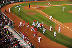 -Boston, MA, October 13, 2013 - Jarrod Saltalamacchia runs a victory lap after hitting a walk-off single as the Red Sox defeat the Tigers, 6-5 in Game 2 of the ALCS.  (Photo by Marissa McClain/Boston Red Sox)