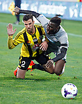 Wellington Phoenix's Manny Muscat, left and Newcastle United's Massadio Haïdara, right, crash to the ground as they chase the ball in the fourth match of the Football United Tour at Westpac Stadium, Wellington, New Zealand, Saturday, July 26, 2014. Credit: Dean Pemberton