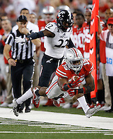 Ohio State Buckeyes running back Ezekiel Elliott (15) dives forward for a first down past Cincinnati Bearcats safety Zach Edwards (22) during the fourth quarter of the NCAA football game at Ohio Stadium in Columbus on Sept. 27, 2014. (Adam Cairns / The Columbus Dispatch)