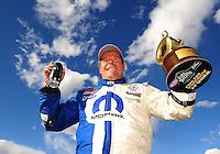 Apr. 1, 2012; Las Vegas, NV, USA: NHRA pro stock driver Allen Johnson celebrates after winning the Summitracing.com Nationals at The Strip in Las Vegas. Mandatory Credit: Mark J. Rebilas-US PRESSWIRE