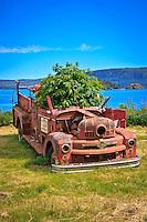 Old fire truck in Skidegate, on Graham Island,  Haida Gwaii,  British Columbia, Canada.