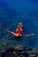 A woman swimming in LaPerouse Bay on Maui