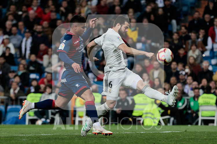 Real Madrid's Nacho Fernandez and SD Huesca's Juan Camilo 'Cucho' Hernandez during La Liga match between Real Madrid and SD Huesca at Santiago Bernabeu Stadium in Madrid, Spain.March 31, 2019. (ALTERPHOTOS/A. Perez Meca)