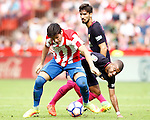Sporting de Gijon's Jorge Mere (l) and FC Barcelona's Rafinha Alcantara (r) and Andre Gomes during La Liga match. September 24,2016. (ALTERPHOTOS/Acero)