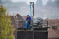 The camera man covers up against the deluge during South Africa vs West Indies, ICC World Cup Warm-Up Match Cricket at the Bristol County Ground on 26th May 2019