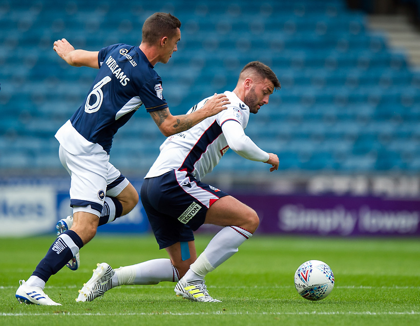 Bolton Wanderers' Gary Madine holds off the challenge from Millwall's Shaun Williams<br /> <br /> Photographer Ashley Western/CameraSport<br /> <br /> The EFL Sky Bet Championship - Millwall v Bolton Wanderers - Saturday August 12th 2017 - The Den - London<br /> <br /> World Copyright &not;&copy; 2017 CameraSport. All rights reserved. 43 Linden Ave. Countesthorpe. Leicester. England. LE8 5PG - Tel: +44 (0) 116 277 4147 - admin@camerasport.com - www.camerasport.com