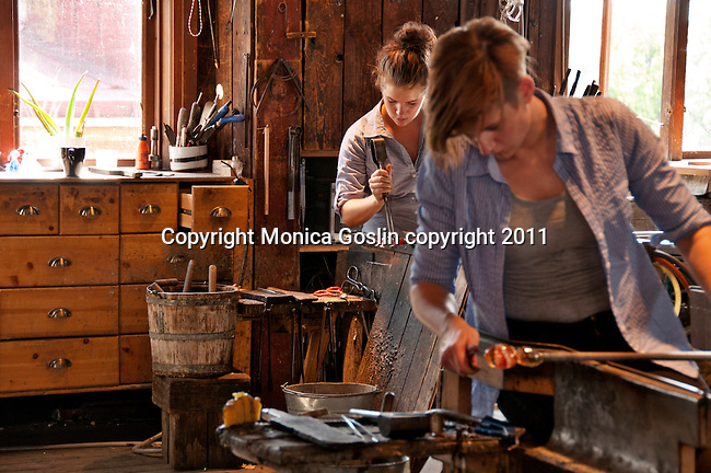 Women working in a glass factory at Skansen, the outdoor historical park in Stockholm, Sweden