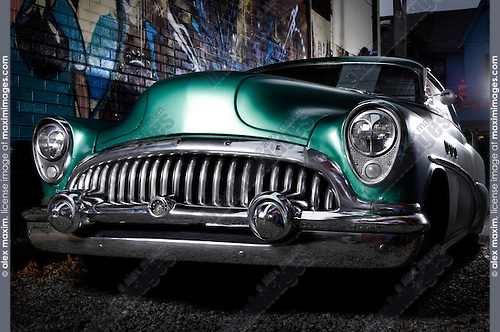 1953 Buick Roadmaster Green classic retro car in a graffiti painted lane