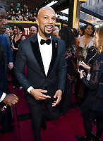Common arrives at the Oscars on Sunday, March 4, 2018, at the Dolby Theatre in Los Angeles. (Photo by Charles Sykes/Invision/AP)