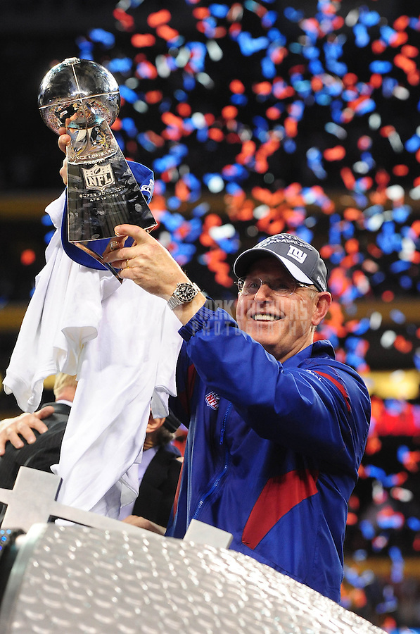 Feb 5, 2012; Indianapolis, IN, USA; New York Giants head coach Tom Coughlin holds up the Vince Lombardi trophy after the Giants defeated the New England Patriots 21-17 in Super Bowl XLVI at Lucas Oil Stadium.  Mandatory Credit: Mark J. Rebilas-