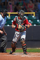 Great Lakes Loons catcher Garrett Kennedy (14) checks the runner during a game against the Clinton LumberKings on August 16, 2015 at Ashford University Field in Clinton, Iowa.  Great Lakes defeated Clinton 3-2 in ten innings.  (Mike Janes/Four Seam Images)