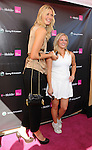CANOGA PARK, CA. - October 31: Maria Sharapova and guest attend the launch of the Sony Ericsson Equinox Phone at the T-Mobile Store on October 31, 2009 in Canoga Park, California.