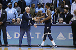 28 December 2016: UNC head coach Roy Williams (left) and Monmouth's Je'lon Hornbeak (right) shake hands before the game. The University of North Carolina Tar Heels hosted the Monmouth University Hawks at the Dean E. Smith Center in Chapel Hill, North Carolina in a 2016-17 NCAA Division I Men's Basketball game. UNC won the game 102-74.