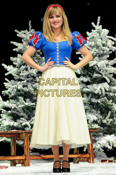 TINA O'BRIEN.First Family Entertainment theatre company's annual group Pantomime photocall at Piccadilly Theatre, London, England..November 26th, 2010.stage costume panto pantomime full length blue dress yellow snow white white hands on hips .CAP/CAS.©Bob Cass/Capital Pictures.