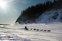 Ray Redington Jr. runs on the Yukon river shortly before the Anvik checkpoint
