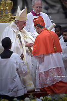 Pope Francis (R) puts on the berretta square cap (Biretta) on the head of Spanish prelate Miguel Angel Ayuso Guixot (L) as he appoints him Cardinal during an Ordinary Public Consistory for the creation of new cardinals, for the imposition of the biretta, the consignment of the ring and the assignment of the Title or Diaconate, on October 5, 2019 at St. Peter's Basilica in the Vatican. Pope Francis appoints 13 new cardinals at the 2019 Ordinary Public Consistory, choosing prelates whose lifelong careers reflect their commitment to serve the marginalized and local church communities, hailing from 11 different nations and representing multiple religious orders.