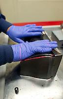Jesse Galvan applying prepreg on a OGV-CF34-10 layup mold
