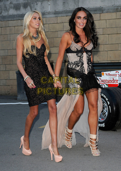 PETRA ECCLESTONE & TAMARA ECCLESTONE.The F1 Party held at the Natural History Museum, London, England, UK..5th July 2010.Formula one full length black strapless dress pink patent platform heels shoes beige holding hands skinny thin dress peach nude long train sisters family siblings lace strappy sandals .CAP/CAN.©Can Nguyen/Capital Pictures.