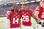 Wisconsin Badgers teammates D'Cota Dixon (14) and Eric Burrell (26) celebrate a win after an NCAA Big Ten Conference football game against the Maryland Terrapins Saturday, October 21, 2017, in Madison, Wis. The Badgers won 38-13. (Photo by David Stluka)