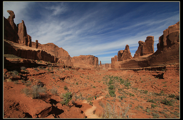 Hiking trail through the Park Avenue rock formations, Arches National Park, Utah.<br /> Outside Imagery offers Arches National Park photo tours.  Year-round Utah photo tours.