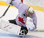 PyeongChang 8/3/2018 - Dominic Larocque, of Quebec City, QC, makes an acrobatic save as Canada's sledge hockey team practices ahead of the start of competition at the Gangneung practice venue during the 2018 Winter Paralympic Games in Pyeongchang, Korea. Photo: Dave Holland/Canadian Paralympic Committee