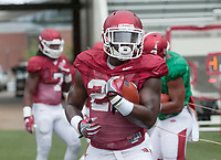 NWA Democrat-Gazette/MICHAEL WOODS • @NWAMICHAELW<br /> University of Arkansas running back Rawleigh Williams III runs drills during the Razorbacks practice Saturday, August 20, 2016 at Razorback Stadium.