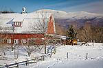Winter snow blankets a farm under Mount Mansfield in Jericho, VT, USA