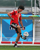 Germany coach Joachim Loew does keepy uppys during training ahead of tomorrow's semi final vs Brazil