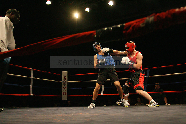 Drew Barnett of Alpha Tau Omega dodges a punch from Trevor Rice of Phi Kappa Psi during The Main Event hosted by Alpha Delta Pi and Sigma Chi  at the Lexington Convention Center in Lexington, Ky., on Thursday, November 7, 2013. Photo by Michael Reaves | Staff