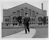 Fielding Yost walking in front of Yost Field House.