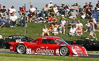 21 June 2009:  The #99 Pontiac Riley of Jon Fogarty and Alex Gurney races past fans during the EMCO Gears Road Racing Classic at Mid-Ohio Spotts Car Course ini Lexington, OH.