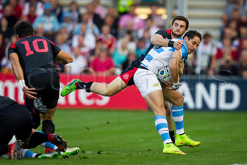 25.09.2015. Kingsholm, Gloucester England. Rugby World Cup. Argentina versus Georgia. Vasil Lobzhanidze of Georgia attempts to bring down Joaquin Tuculet of Argentina .