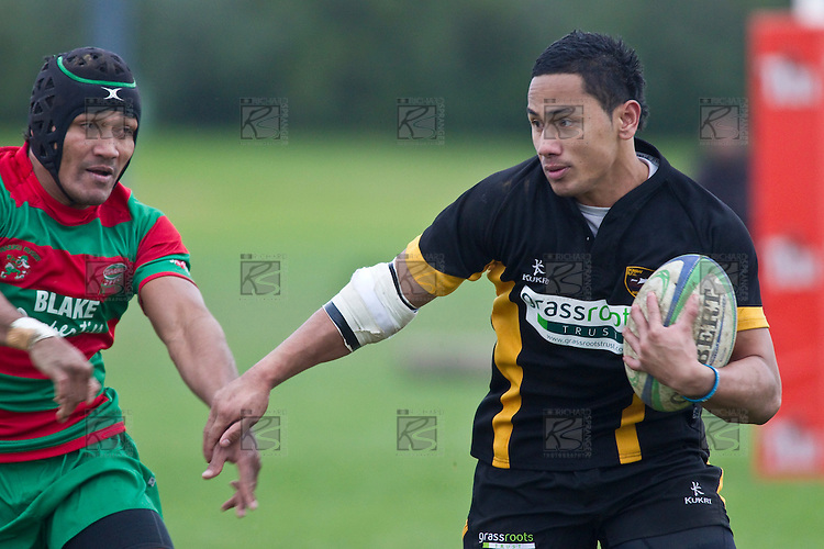 Toni Pulu pushes Sio Petelo's hand away as he makes a break. Counties Manukau Premier Club Rugby game between Waiuku and Bombay, played at Waiuku on Saturday July 5th 2010. Waiuku won 59 - 14 after trailing 12 - 14 at halftme.