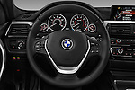 Car pictures of steering wheel view of a 2017 BMW 3-Series 330i-Sports-Wagon 5 Door Wagon Steering Wheel