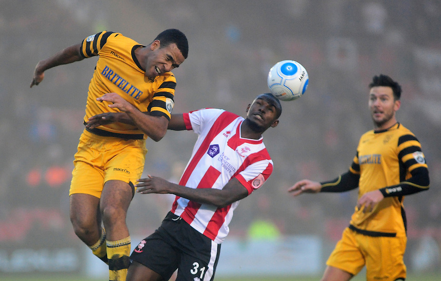 Lincoln City&rsquo;s Theo Robinson vies for possession with Maidstone United's Kevin Lokko<br /> <br /> Photographer Andrew Vaughan/CameraSport<br /> <br /> Vanarama National League - Lincoln City v Maidstone - Saturday 26th November 2016 - Sincil Bank - Lincoln<br /> <br /> World Copyright &copy; 2016 CameraSport. All rights reserved. 43 Linden Ave. Countesthorpe. Leicester. England. LE8 5PG - Tel: +44 (0) 116 277 4147 - admin@camerasport.com - www.camerasport.com
