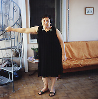 Assia Cerciello (cq) at her home in Marigliano, Italy near Naples, Italy, June 24, 2010. Cerciello, suffers from a variety of illnesses including, diabetes, Hashimoto's thyroiditis, hypertension, uterus cancer and diabetic neuropathy affecting her nervous system. Her health issues started when toxic waste build up began in the historical irrigation canal, Vasca San Sossio, which run by her neighborhood. A majority of the families in her neighborhood have similar health issues...PHOTOS/ MATT NAGER