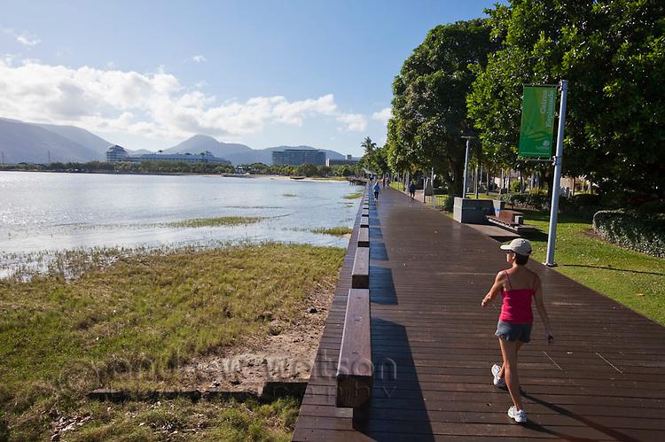 Woman walking along the Esplanade boardwalk.  Cairns, Queensland, Australia