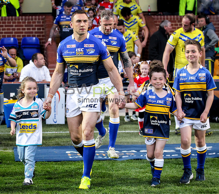 Picture by Alex Whitehead/SWpix.com - 24/04/2015 - Rugby League - First Utility Super League - Leeds Rhinos v Warrington Wolves - Headingley Carnegie Stadium, Leeds, England - Leeds captain Kevin Sinfield leads his side out for kick-off as he celebrates his 500th game for the club.