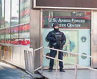 An NYPD counterterrorism officer at his post in Times Square on Tuesday, March 22, 2016. Security in New York has been heightened in the wake of the terrorist bombings in Brussels, Belgium. (© Richard B. Levine)