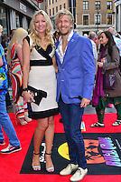 Rachel Gretton &amp; Rick Parfitt Jnr<br /> The &quot;Bula Quo!&quot; UK film premiere, Odeon West End cinema, Leicester Square, London, England.<br /> July 1st, 2013<br /> full length black white dress blue suit jacket jeans denim couple <br /> CAP/BF<br /> &copy;Bob Fidgeon/Capital Pictures