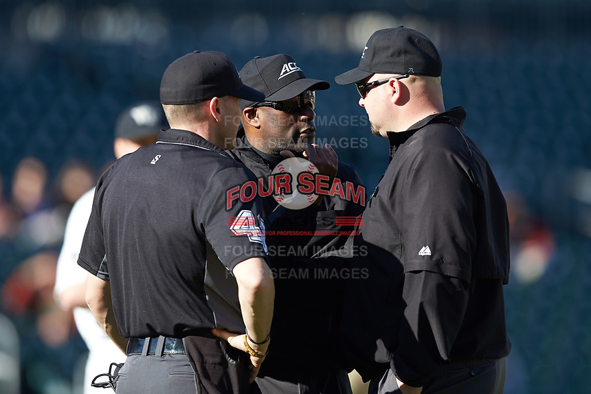 Third base umpire Linus Baker confers with first base umpire Wilson Raynor (right) and home plate umpire Jon Byrne during the NCAA baseball game between the Furman Paladins and the Wake Forest Demon Deacons at BB&T BallPark on March 2, 2019 in Charlotte, North Carolina. The Demon Deacons defeated the Paladins 13-7. (Brian Westerholt/Four Seam Images)