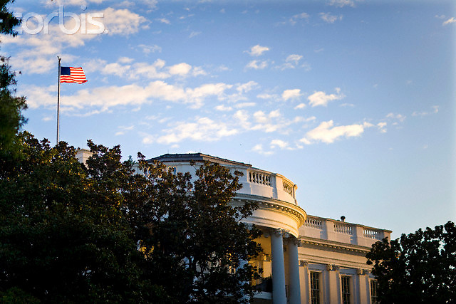 29 Sep 2008, Washington, DC, USA --- An American flag flies over the White House in Washington.  --- Image by © Brooks Kraft/Corbis