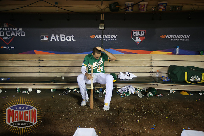 OAKLAND, CA - OCTOBER 02:  Matt Olson #28 of the Oakland Athletics sits in the dugout after the American League Wild Card Game against the Tampa Bay Rays at RingCentral Coliseum on Wednesday, October 2, 2019 in Oakland, California. (Photo by Brad Mangin)