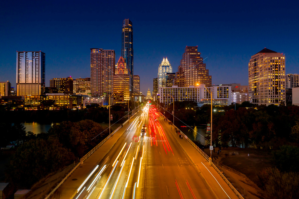 The Congress Avenue Bridge is the gateway to downtown Austin and perhaps the most famous bridge in Texas, visited by over 100,000 tourists each year that come to see the Congress Ave. Bridge Bats. The bridge crosses over Lady Bird Lake and is the boundary between north and south Austin.