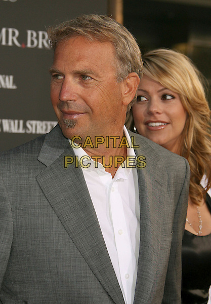"KEVIN COSTNER & CHRISTINE BAUMGARTNER.""Mr. Brooks"" Los Angeles Premiere at Grauman's Chinese Theatre, Hollywood, California, USA..May 22nd, 2007.half length grey gray suit jacket soul patch facial hair married husband wife couple .CAP/ADM/RE.©Russ Elliot/AdMedia/Capital Pictures"